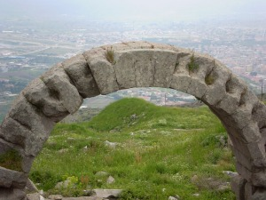 An arch way and a view of the town below.