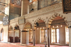 The main floor has a huge space for worship surrounded by walkways to the other parts of the mosque.